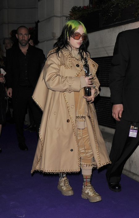 Billie Eilish arrives at the Brit Awards Universal Music Afterparty, held at The Ned Hotel, clutching her Brit Award that she won for Best International Female. Billie was wearing head to toe Burberry