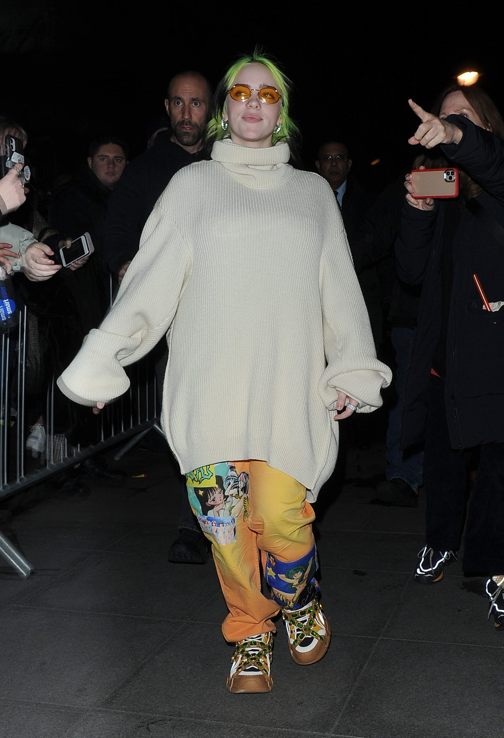Billie Eilish leaving the BBC Radio 1 studios, having co-hosted the drive time show with Nick Grimshaw. The Brit Award winner was wearing typically outlandish fashion