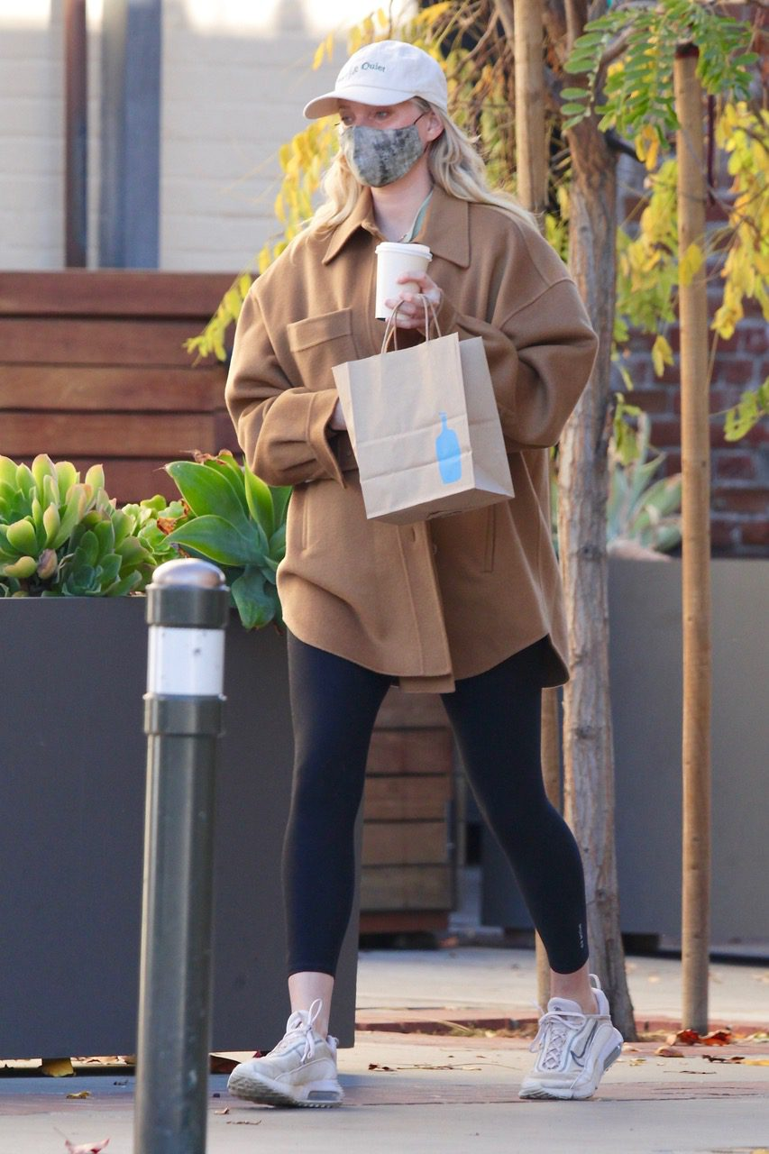 EXCLUSIVE: Pregnant, Supermodel Elsa Hosk shows off her baby bump while out on a coffee run