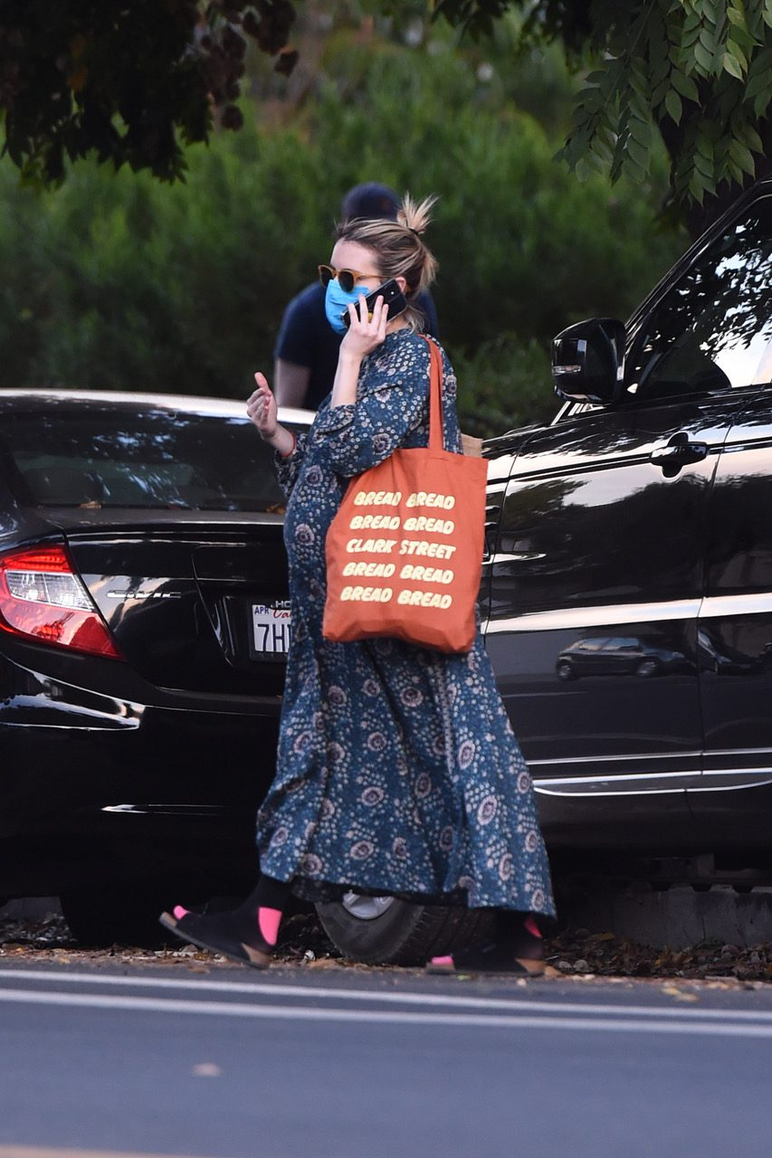 EXCLUSIVE: A pregnant Emma Roberts is seen heading to a friends house
