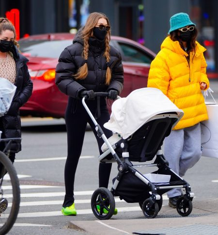Gigi Hadid go shopping in Soho with her baby in stroller with friends in New York