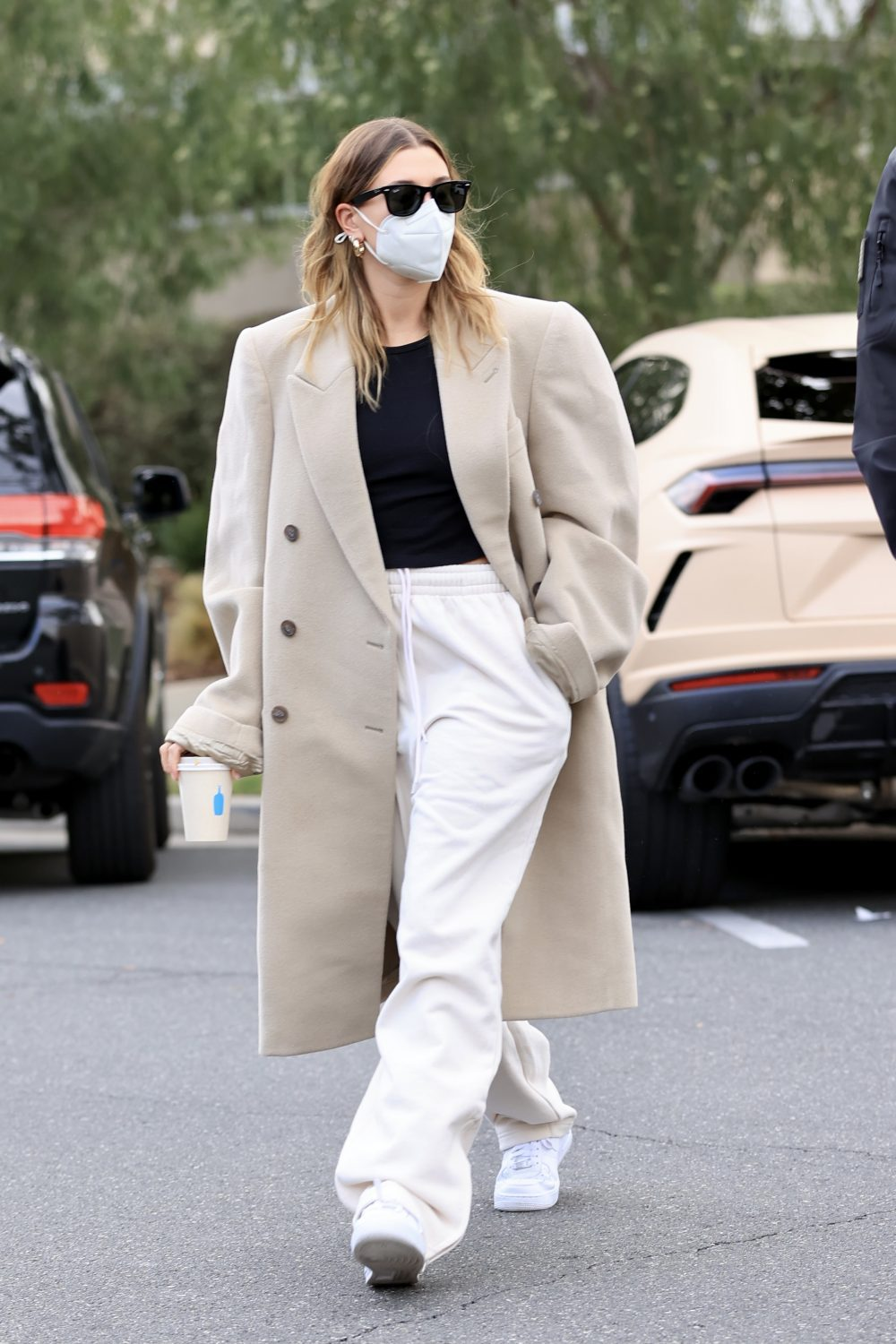 Hailey Bieber stuns in a white outfit heading to a meeting