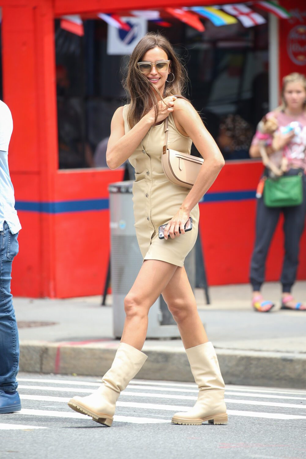 Irina Shayk wears a mini dress with matching boots while out and about in NYC