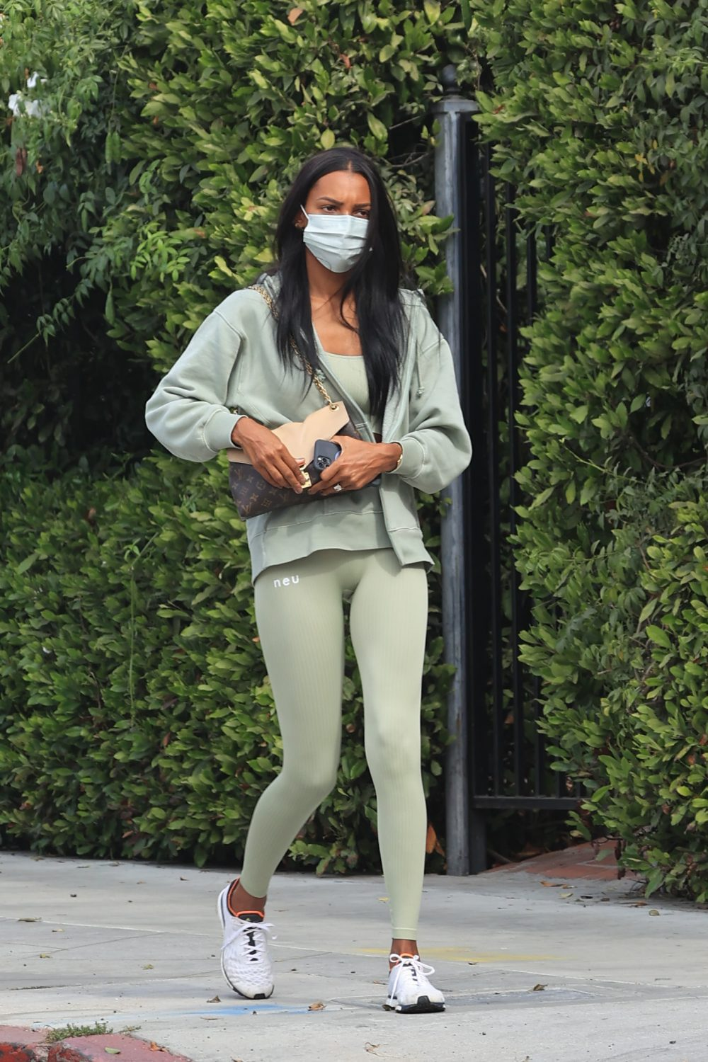 Jasmine Tookes dressed in all green heading to the gym