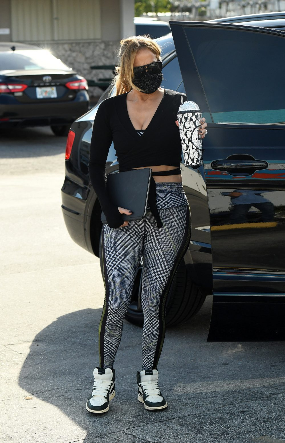 Jennifer Lopez shows off her midriff while showing up to the gym in Miami