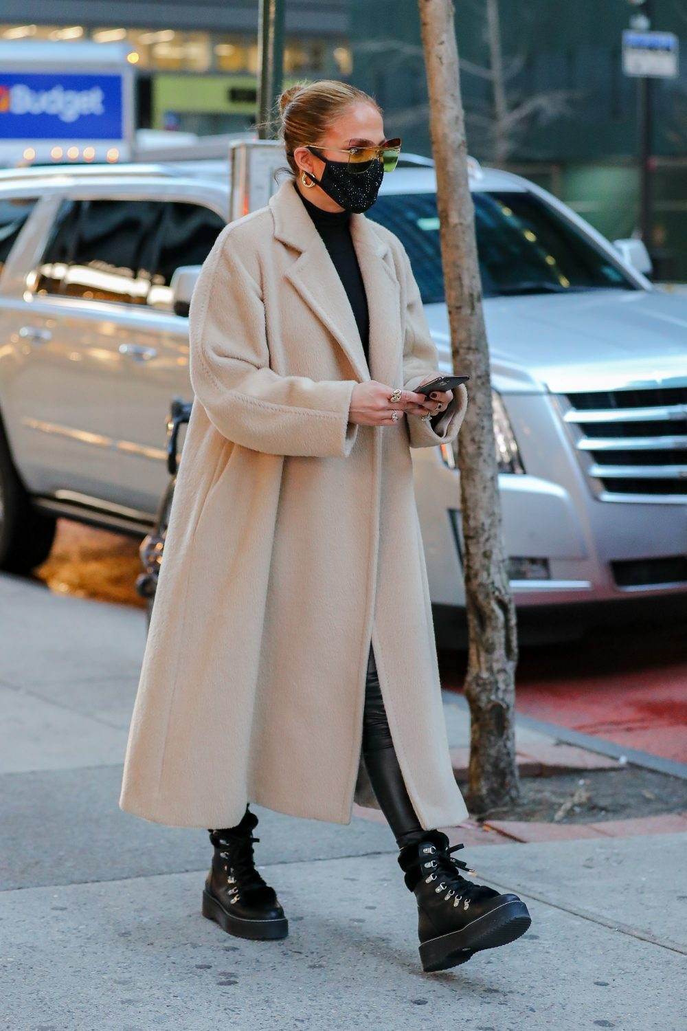 Jennifer Lopez was spotted shopping for Christmas while visiting Dior and Hermes stores in New York City