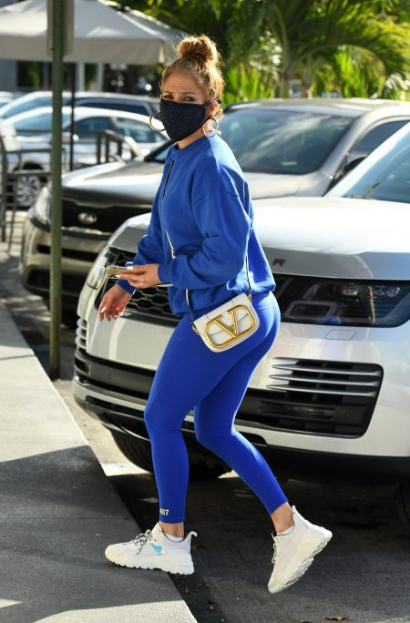 Jennifer Lopez goes shopping in blue sweats with Valentino purse in Miami