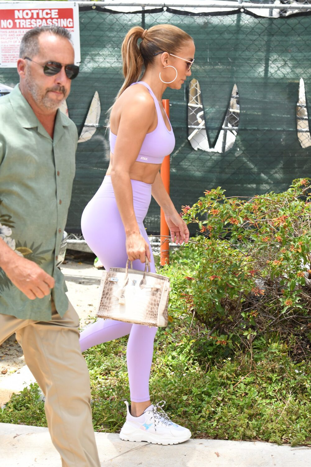 Jennifer Lopez wears a purple outfit and designer bag as she hits the gym in Miami
