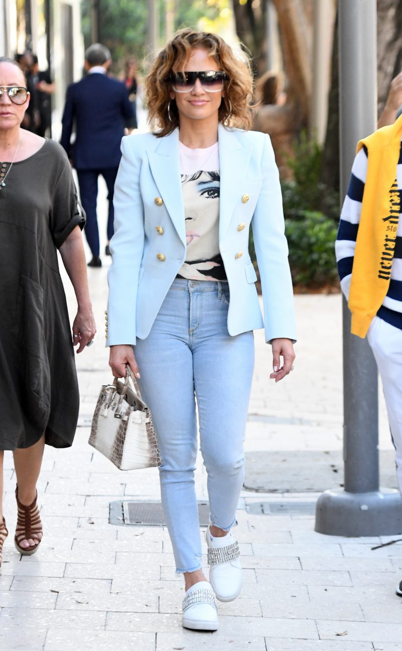Jennifer Lopez shows off her natural wavy hair as she hits the shops of the Design District in Miami