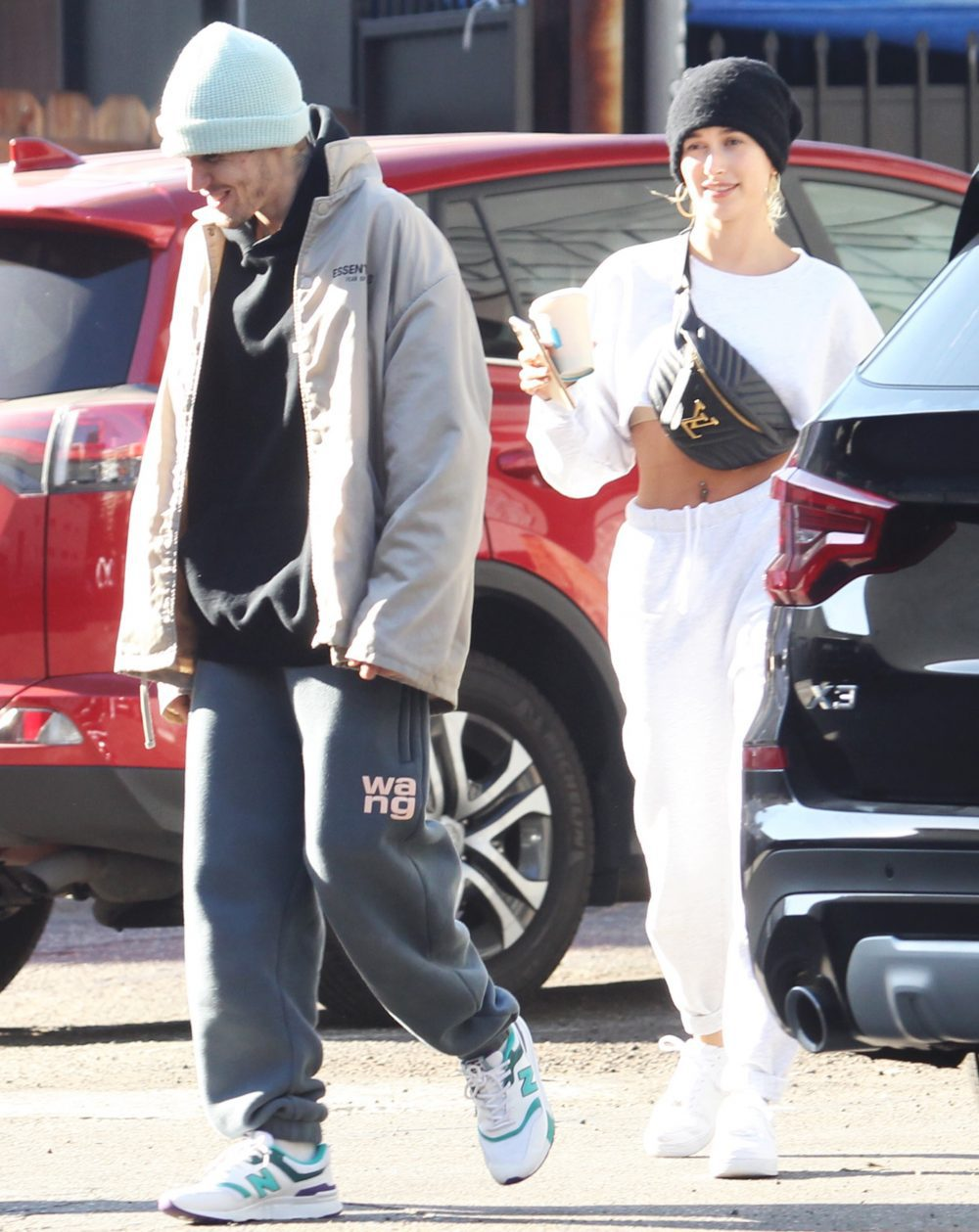 Justin Bieber and wife Hailey Rhode Bieber laughing together as they go out in Los Angeles