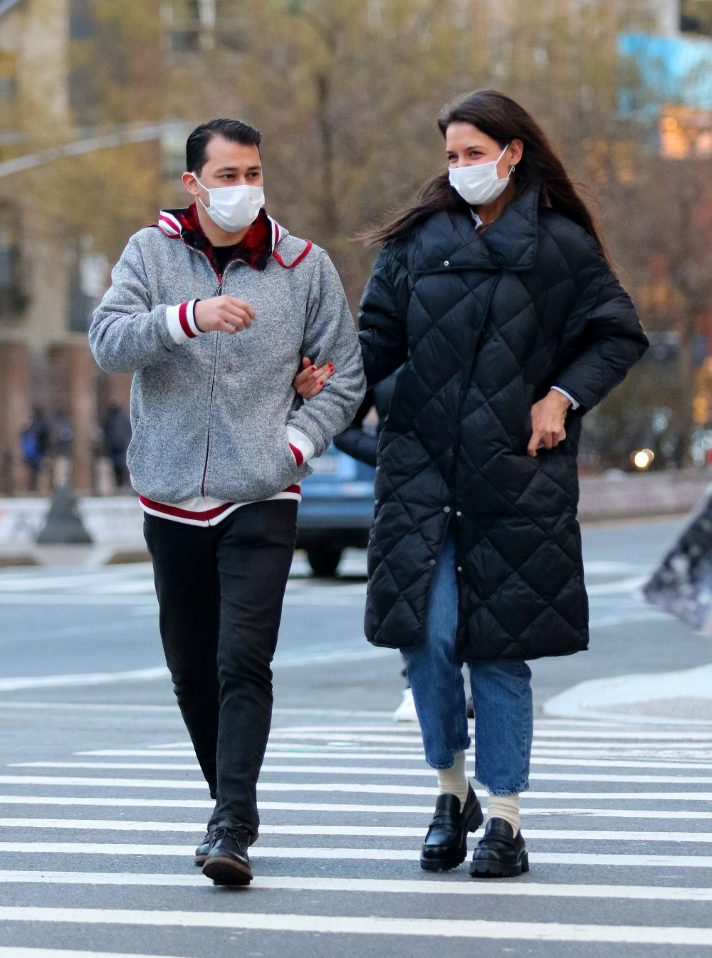 Katie Holmes looks very happy holding Emilio Vitolo Jr's arm while out for a walk in NYC