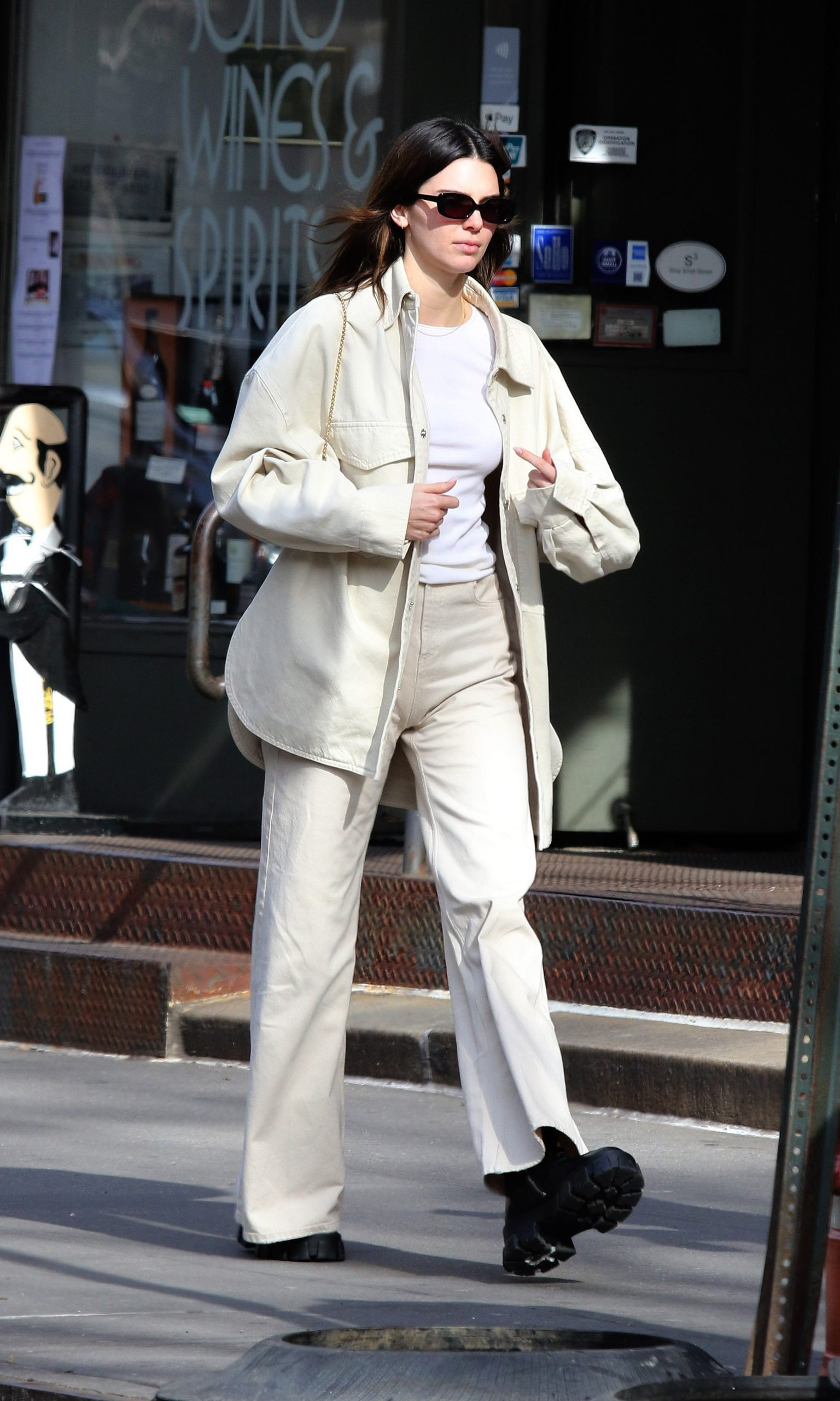 Kendall Jenner enjoys the nice weather as she goes for a walk with friends after having lunch in NYC