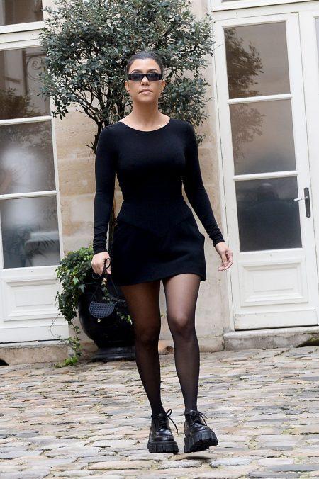 Kim Kardashian and sister Kourtney Kardashian arrive at Le Flore Cafe in Paris
