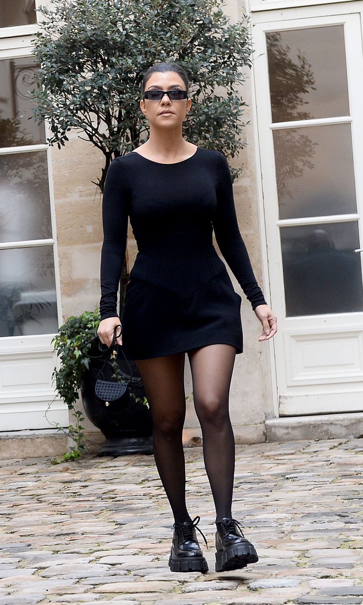 Kim Kardashian and sister Kourtney Kardashian arrive at Le Flore Cafe in Paris