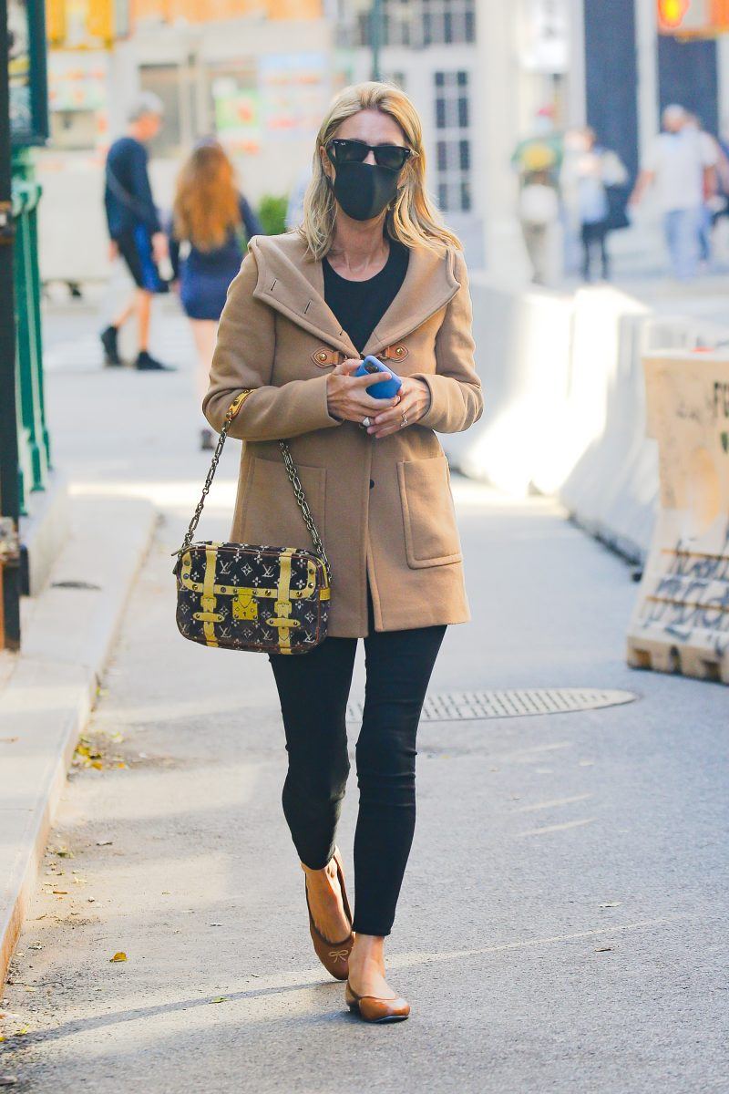 Nicky Hilton seen carrying her Louis Vuitton handbag as taking a stroll in NYC