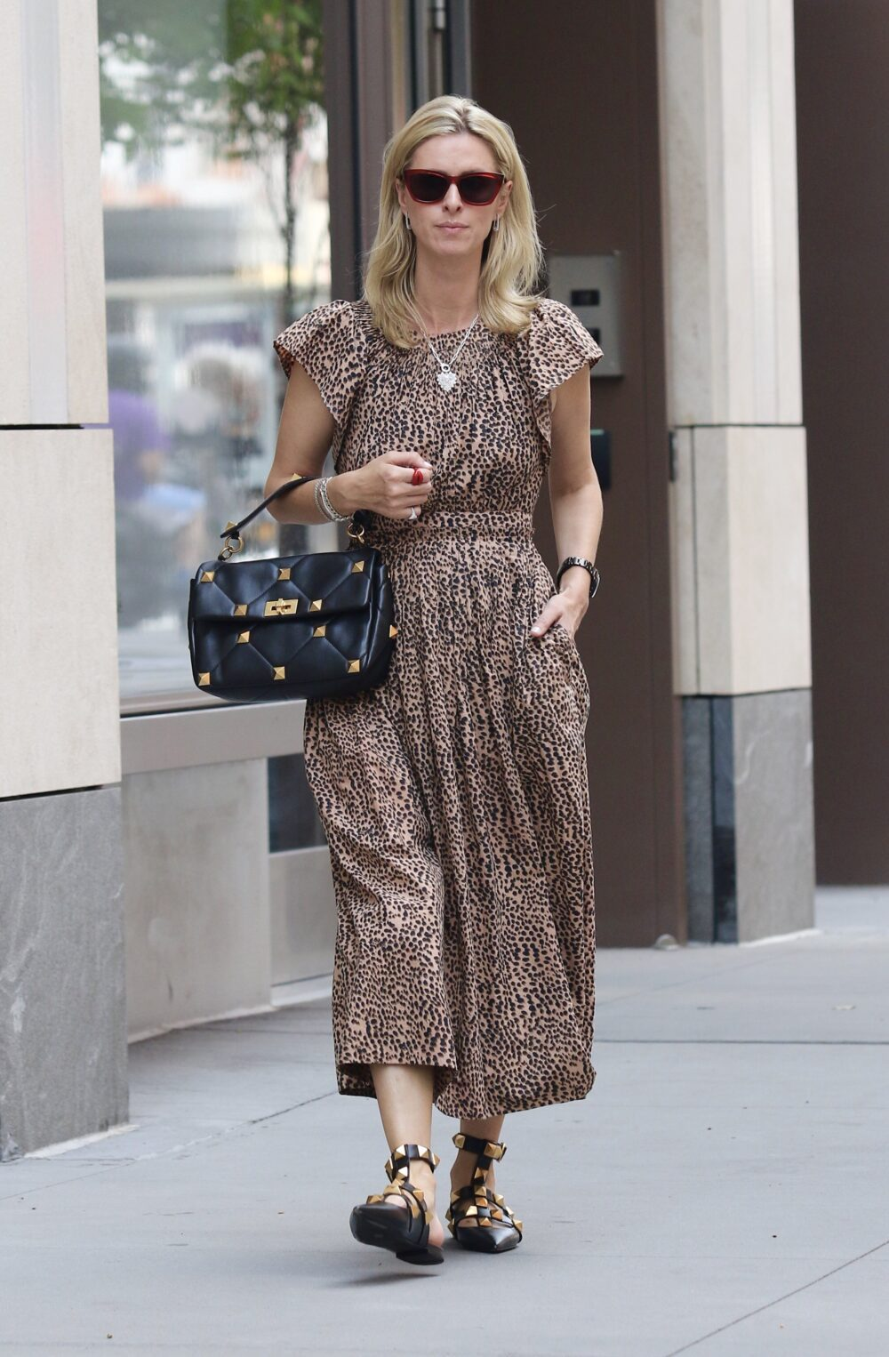 Nicky Hilton looks stylish sporting a leopard print dress while braving the heatwave in NYC