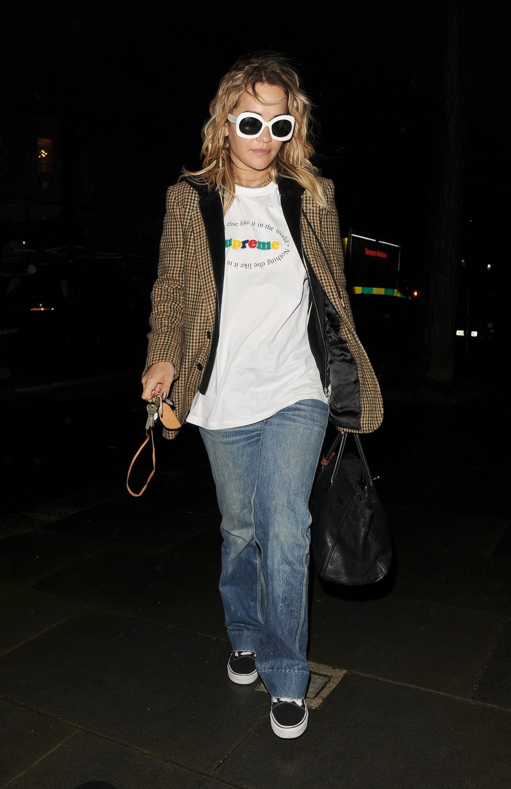Rita Ora is seen back in London for the first time in 3 months, having enjoyed an extended vacation in Los Angeles. Rita wore jeans, a Supreme T-shirt and a tweed jacket for the low key outing in Notting Hill
