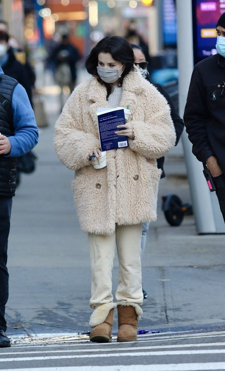 Selena Gomez bundles up for the cold weather while carrying a book on the set of Only Murders in the Building in NYC